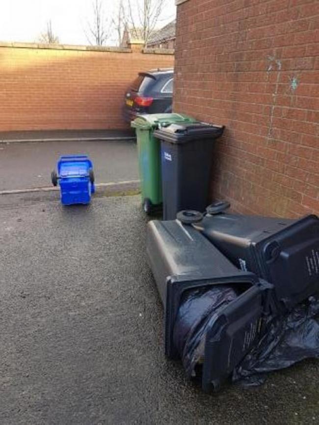 BINS: Leah Magari sent this picture of slim bins blown over by the string winds in Back Market Street, Little Lever.