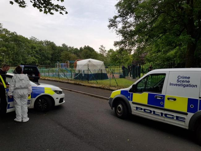 Forensics officers at Thomasson Park in Halliwell