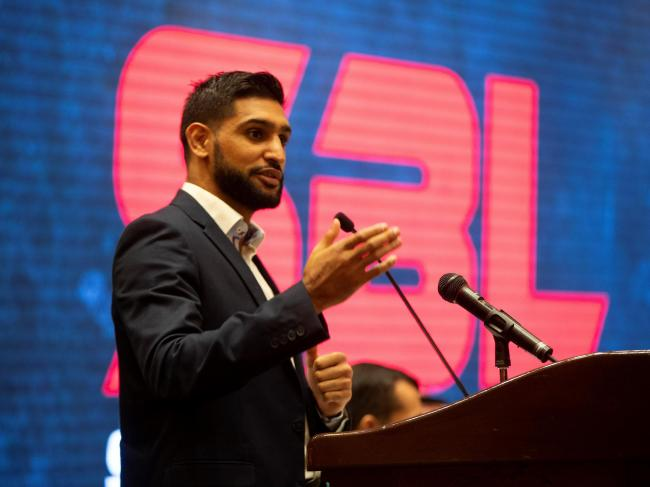 Amir Khan speaking at a press conference ahead of the fight