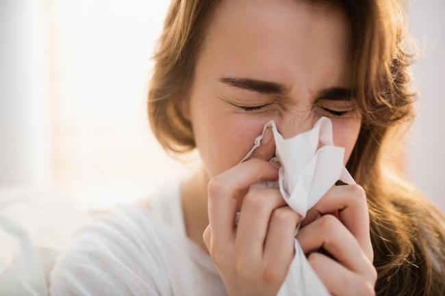 Undated generic stock of a woman sneezing with hayfever. See PA Feature TOPICAL Health Hayfever. Picture credit should read: iStock/PA. WARNING: This picture must only be used to accompany PA Feature TOPICAL Health Hayfever.