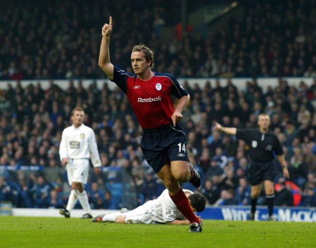 Kevin Davies scores a goal against Leeds United in his first season at Wanderers