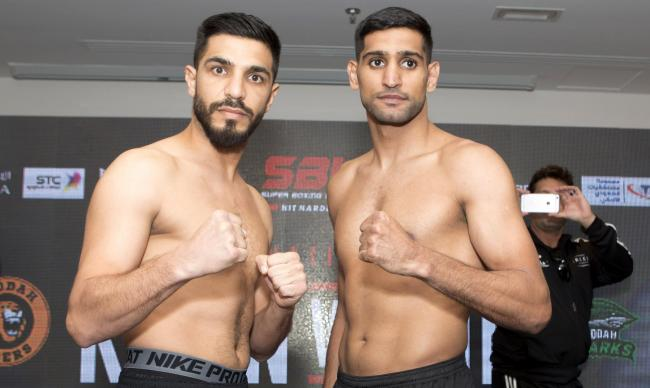 Billy Dib, left, and Amir Khan at the weigh in. Picture: Super Boxing League