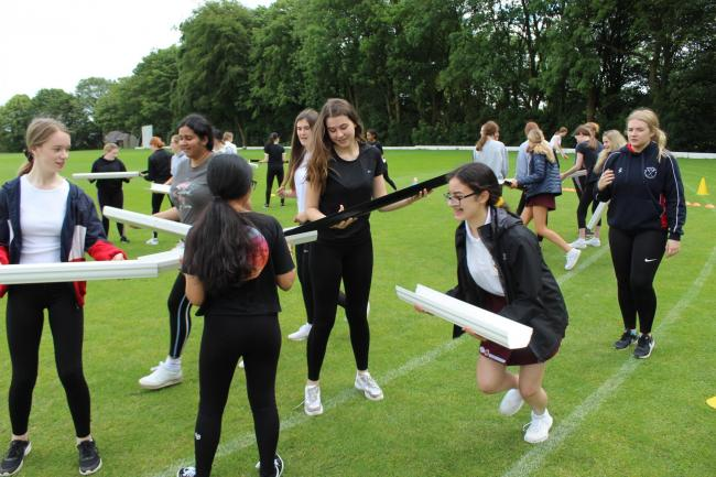 TEAMWORK:Bolton School girls face a number of challenges set by Commando Joe