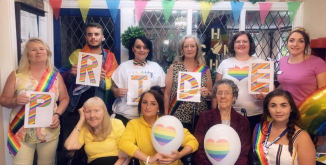 CELEBRATING: Staff and residents celebrate Pride