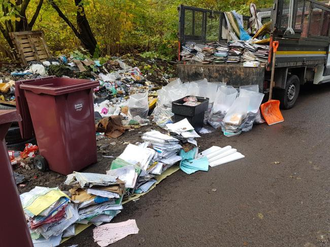 Confidential documents are removed from fly tip outside Raikes Lane recycling centre