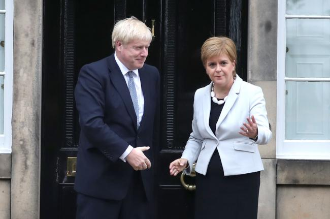 RETRANSMITTED CORRECTING BYLINE..Scotland's First Minister Nicola Sturgeon welcomes Prime Minister Boris Johnson outside Bute House in Edinburgh ahead of their meeting. PRESS ASSOCIATION Photo. Picture date: Monday July 29, 2019. See PA story POLITICS
