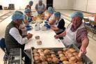 Volunteers help out with the packed lunches drive