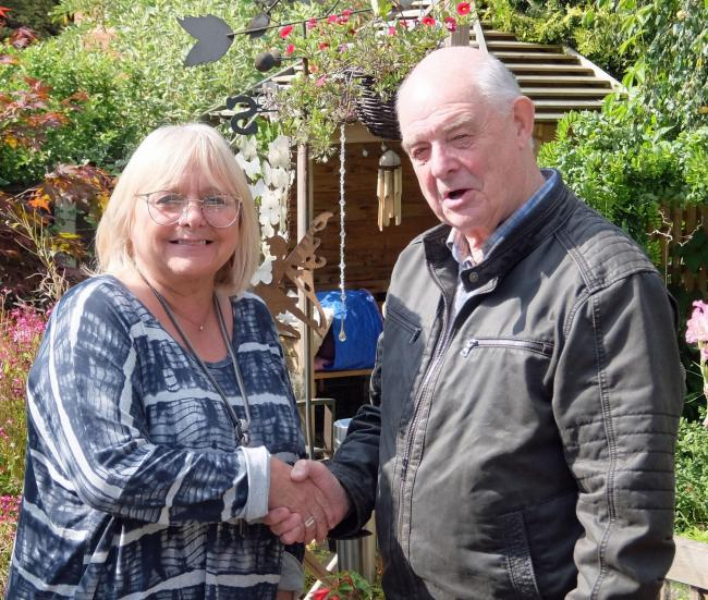 Debbie Newall being welcomed into the Lib Dem Group by Group Leader Councillor Roger Hayes