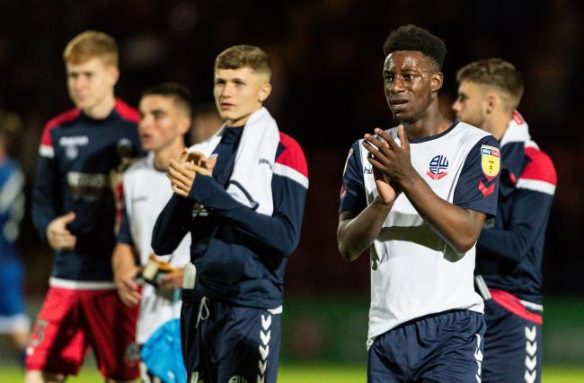 Bolton Wanderers' De'Marlio Brown-Sterling applauds the travelling fans at the end of the match