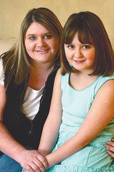 HELP US: Stephanie Grimshaw, left, aged 17, with her sister Zara, aged nine