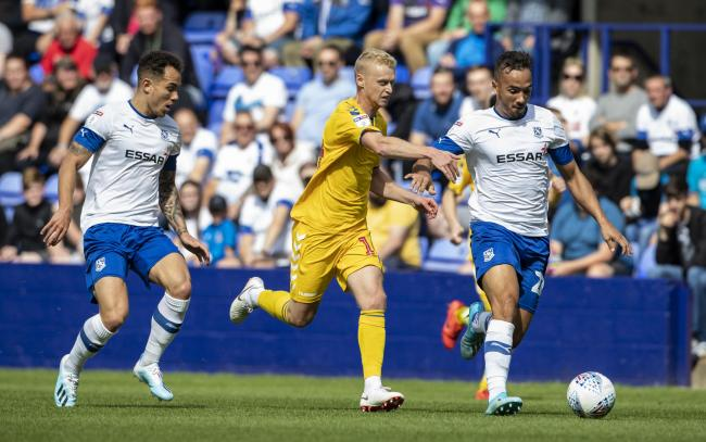 James Weir battles for the ball at Tranmere