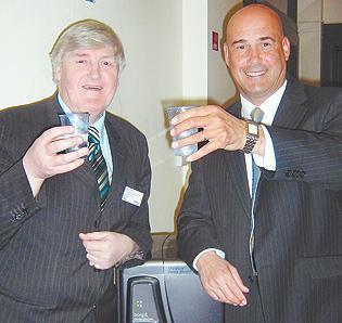 FLASHBACK: Former council leader Cllr Cliff Morris with Nigel Ogumby, of Waterflo, when the council deal was signed in 2009
