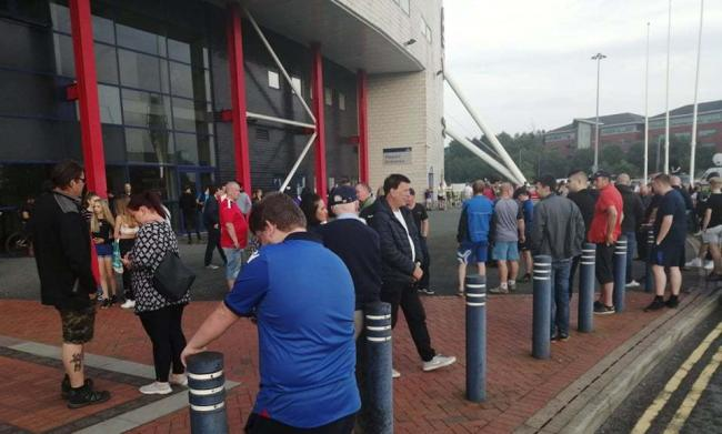 Fans outside the University of Bolton Stadium