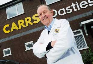 The Bolton News: PASTIE MAN: John Carr, managing director of Carrs Pasties, is proud of his product, baked in their thousands