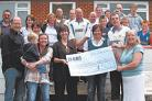 THANK YOU: Members of Kearsley Cricket Club presenting a cheque to Heather Bird, of St Mary's Hospital, who is holding the cheque on the left. Also featured are, front row from the left, John and Carol Burgess, mother and father of Chris Burgess; Carrie R