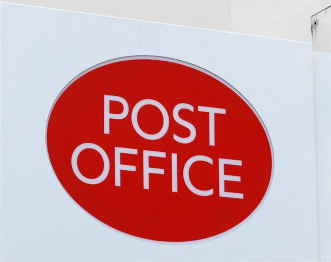 Post Office sign. Photo: Lewis Stickley/PA Wire.