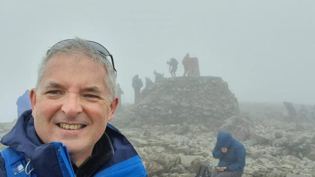 Business coach Paul Limb, on Ben Nevis, as part of the Kent Rhodes Challenge
