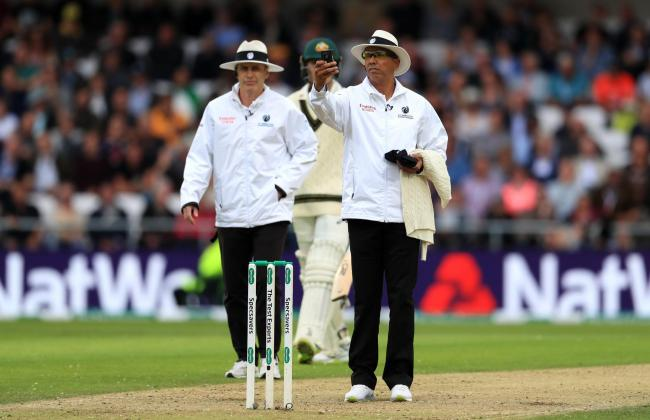 The umpires check for bad light during the Ashes