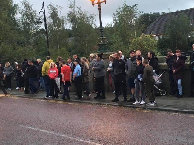People gather on Blackburn Road to remember baby Zakari William Bennett-Eko