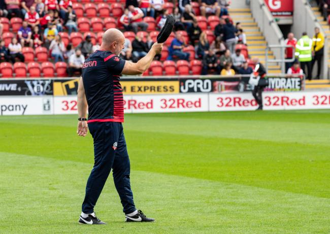 Keith Hill tips his cap to the Bolton Wanderers fans before the game
