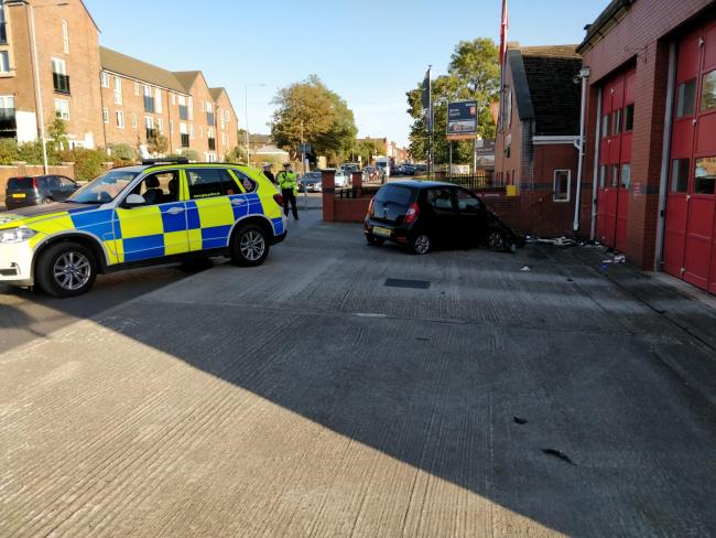Police investigate a crash outside Horwich Fire Station