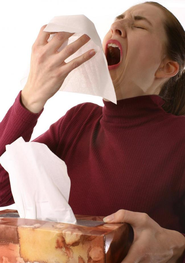 A Generic photo of a woman sneezing as if she has a bad cold or flu. See PA Feature HEALTH Winter. PA Photo/ Generic....WARNING This picture must only be used to accompany PA Feature HEALTH Winter.