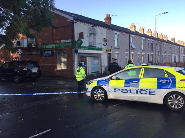 Police on the scene following an incident in Settle Street, Great Lever, Bolton