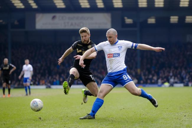 Stephen Dawson, right, in action for Bury