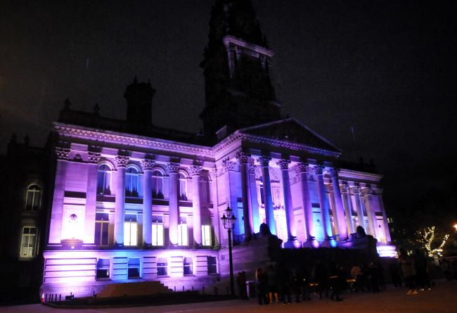 Bolton Town Hall lit up in pink and blue to support Baby Loss Awareness Week