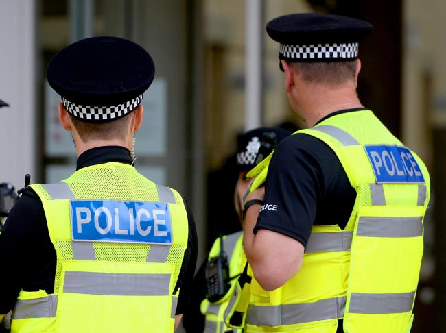 File photo dated 15/09/16 of police officers. The number of sick days taken by police officers because of mental health issues has soared by more than two-thirds in the past five years, an investigation has found..