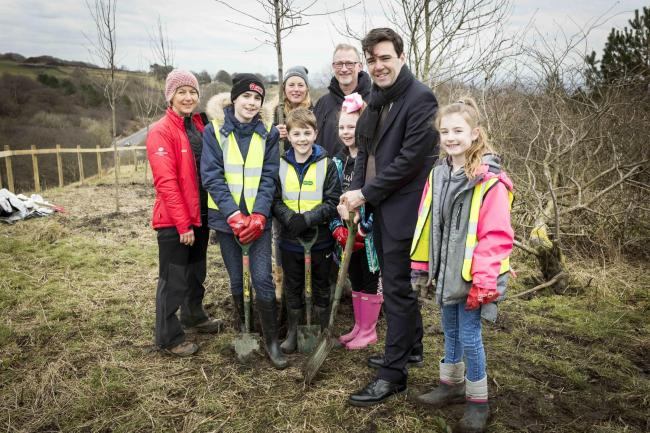 PICTURE BY CHRIS BULL FOR WOODLAND TRUST   14/3/8..Andy Burnham to helps Bolton pupils plant first site of 120 mile new Northern Forest.L-R Chris Reid , head of conservation with The Woodland Trust , Alex Farrar , ten , Jess Thompson lead on health and we