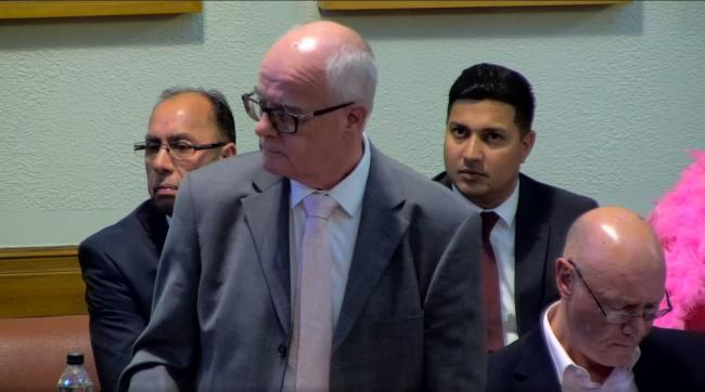Cllr Kevin McKeon speaks at the full council meeting on October 9 with Cllr Hamid Khurram and Cllr Mohammed Ayub behind him