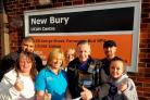 Farnworth PCSO Derrick Thomas hands a cheque to the New Bury Vision Group