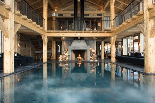 The indoor pool at San Luis Retreat Hotel & Lodges in the Italian Tyrol