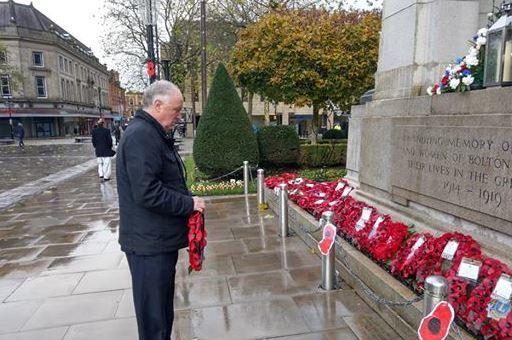 Sir David Crausby lays his wreath yesterday morning