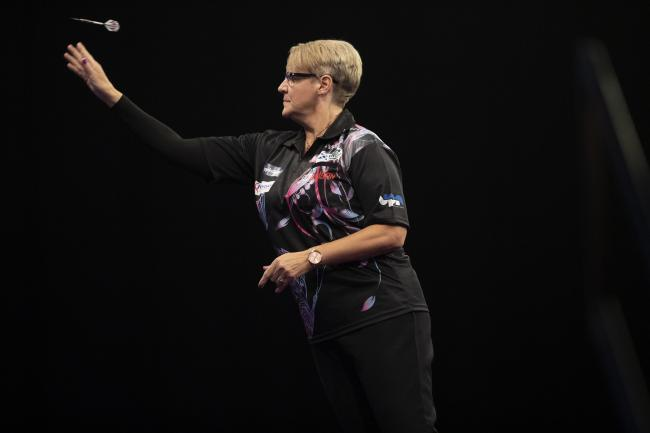 Lisa Ashton in action against Dave Chisnall in Wolverhampton. Picture: Lawrence Lustig/PDC