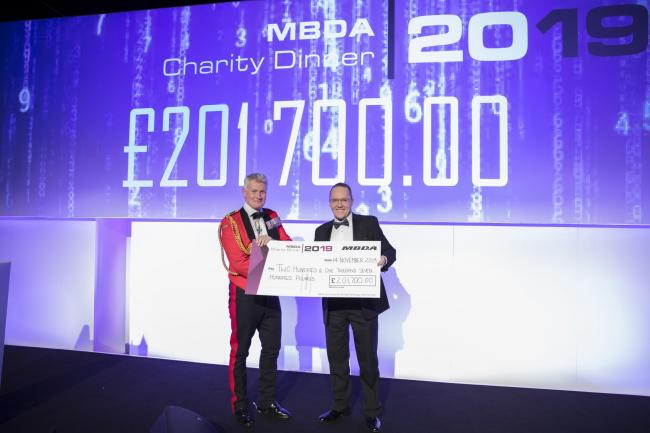 The cash is handed over from the MBDA fundraising dinner