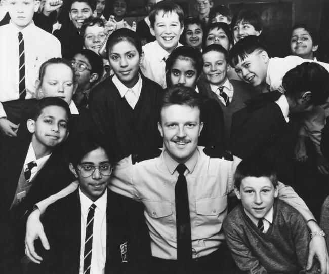 Today's picture from The Bolton News archives shows Pc Martin Gundlach with some of the pupils he met when he  visited Hayward School as part of Police Week in 1990.