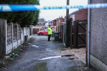 Woman arrested on suspicion of attempted murder after stabbing - Photo