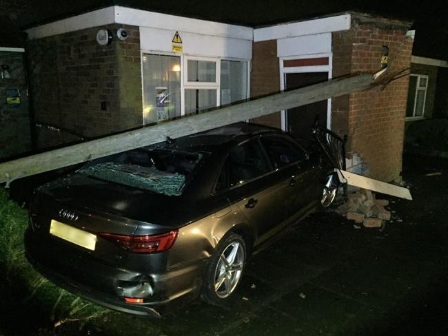 Audi after crashing into housing office in Addington Road, Bolton. Photo courtesy of GMP