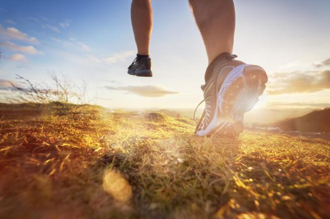 Outdoor cross-country running in morning sunrise concept for exercising, fitness and healthy lifestyle.