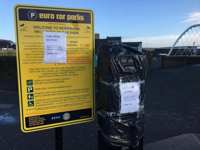 CHARGES: A car parking machine at Morrisons in Bolton has been covered over
