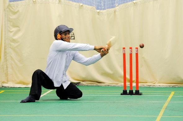 HOWZAT: Disabled cricketer Janak Singh displaying his batting skills at Bolton Indians Sports Club