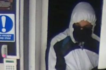 Police release pictures of duo who raided Breightmet Coop - Photo