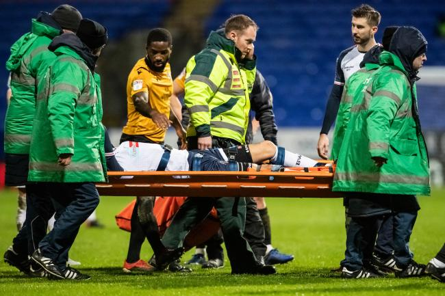 Will Buckley is stretchered off the pitch as Wanderers drew 1-1 with Bristol Rovers