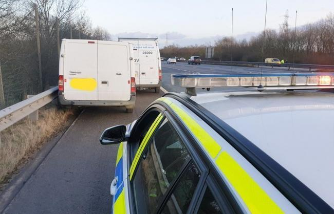 Van stopped by police on M61 J4