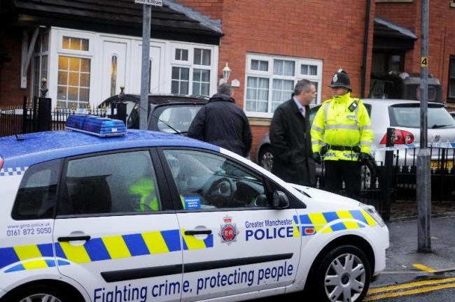 INVESTIGATIONS: Police at the Deane home of Asif Farooqui, who was one of five men in arrested in Greater Manchester