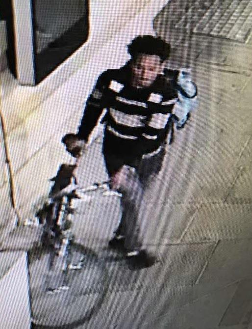 A man police want to speak to in connection with a rape in Manchester