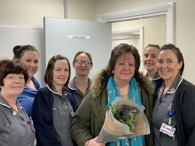 Shirley Bannister being given flowers by the staff on Evergreen ward for her kindness