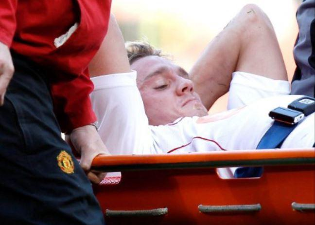 Stuart Holden is taken off the pitch on a stretcher at Old Trafford